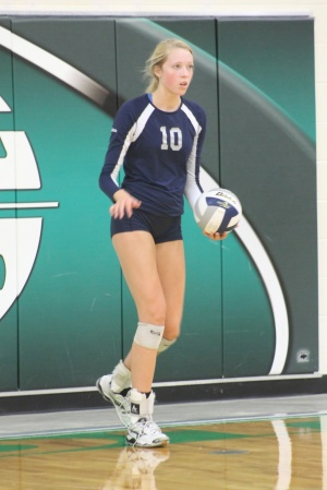 Megan Wickey of Omaha Concordia prepares to serve during a match earlier this year at Columbus Scotus.