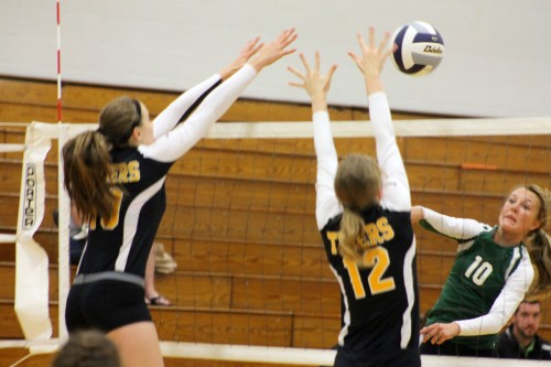 Fremont's Gessica Gdowski, left, and Katie Sorensen go up for a block against Gretna's Amanda Young during a 2013 match. On Tuesday, Gdowski gave her verbal commitment to Nebraska-Omaha.